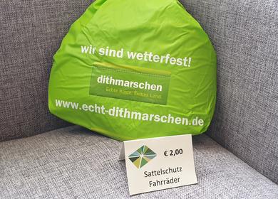 Sattelschutz für das Fahrrad in Grün mit dem Heider Logo 2,00€