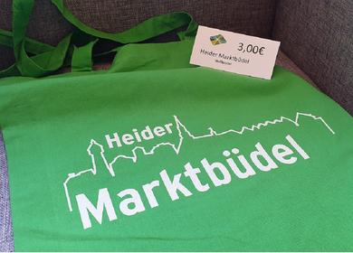 Heider Marktbüdel in Grün mit dem Schriftzug Heide und der Skyline 3€